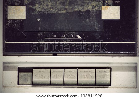 Close up control button of obsolete stereo. - stock photo