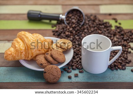 Close up cookies with white coffee cup and beans background - stock photo