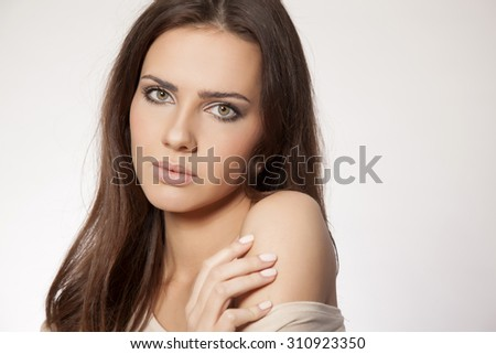 Close up cosmetics portrait of a beautiful young adult attractive sensuality and sexy pretty  brunette woman in brown sweater isolated on white background  - stock photo
