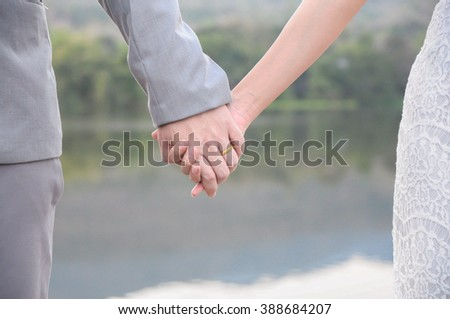 close up couple holding hand together concept of love.