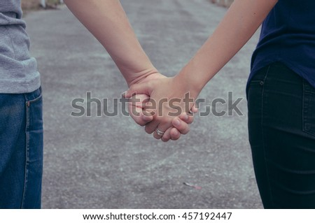 close up couple holding hand together concept of love. selective focus. filter effect. vintage tone