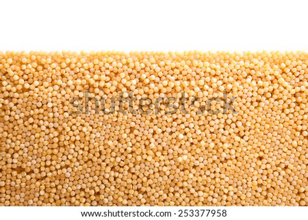 Close up , Couscous heap , isolated on white - stock photo