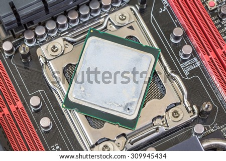 Close up cpu with silicon on modern computer motherboard
