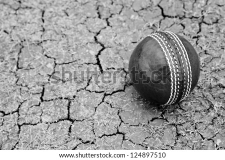 Close up Cricket ball on Pitch with copy space - stock photo