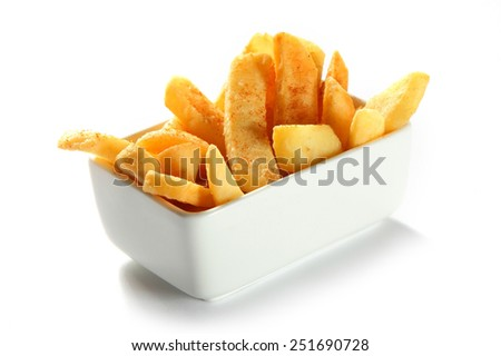 Close up Crispy Potato French Fries on White Bowl Isolated on White Background. - stock photo