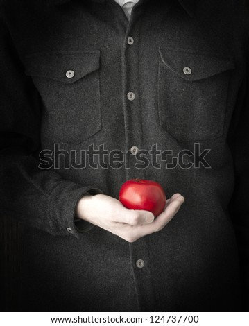 Close up crop of a man holding a red apple