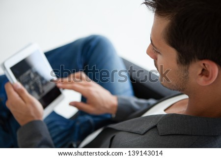 Close up cropped image of an Attractive business man in his 20s working on think pad