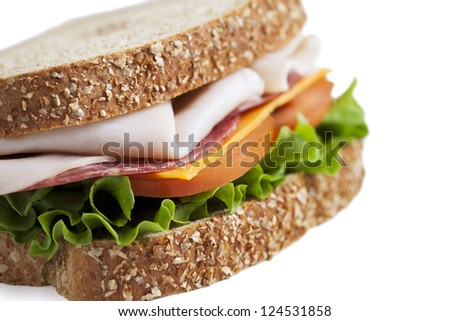 Close-up cropped image of delicious ham sandwich isolated on a white background - stock photo