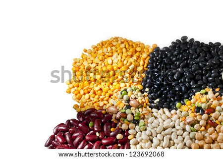 Close-up cropped image of variety of beans against white surface. - stock photo