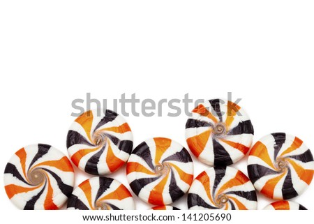 Close-up cropped shot of multi colored hard candies isolated over white background. - stock photo