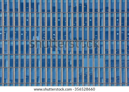 Close up cropped shot of skyscraper window frames in blue metal. - stock photo