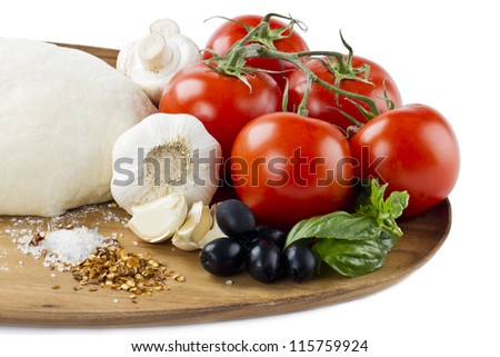 Close-up cropped shot of vegetables and other pizza ingredients on wooden plank. - stock photo