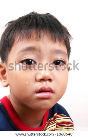 Close-up crying boy - stock photo