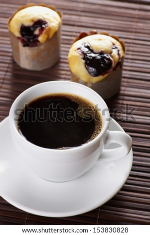 Close up cup of coffee witk sweet cake