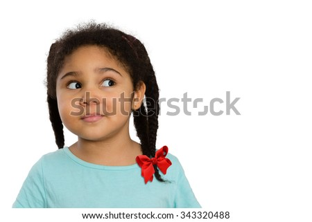 Close up Curious Four-Year Old African American Girl Looking to the Side Against White Background. - stock photo
