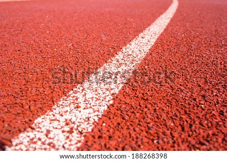 Close up curve running track rubber standard red color - stock photo