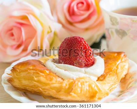 close up danish pastry with fruit on wood table - stock photo