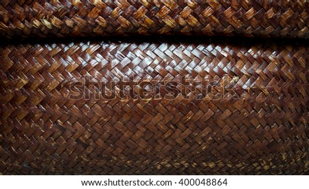 Close up dark brown woven bamboo pattern.close up concept.background concept.