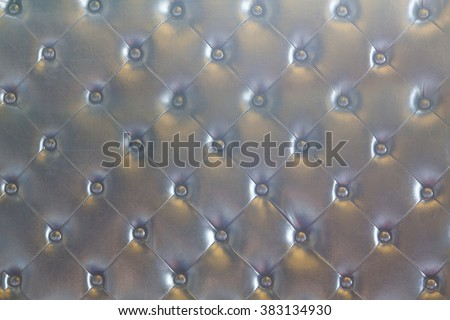 Close up dark luxury buttoned leather. - stock photo