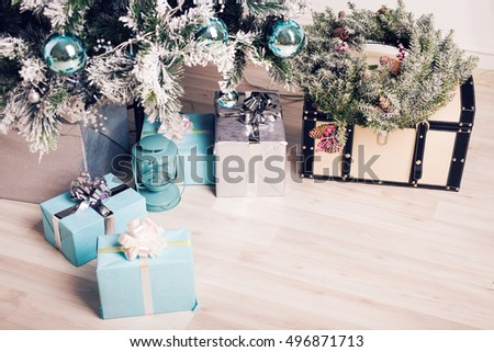 Close up decorated fir tree and gift boxes