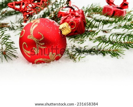 Close-up decoration of red christmas bauble with red gifts, star and twig of christmas tree