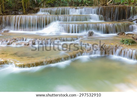 Close up deep forest water fall during spring in national park of Thailand - stock photo