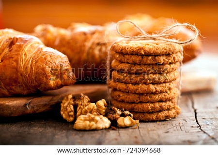 Close up delicious cookies and nuts, macro food background