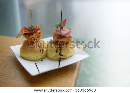 close up delicious crispy bacon  roll on bread  - stock photo