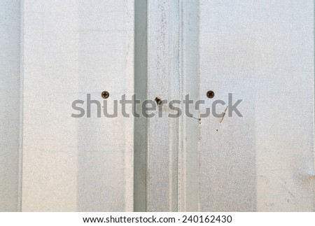 Close up detail fixing of metal sheet temporary fence - stock photo