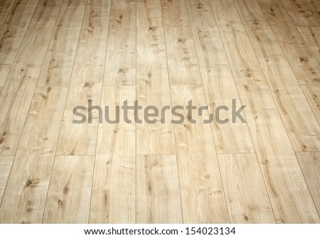 Close up detail of a beautiful wooden brown laminated floor - stock photo