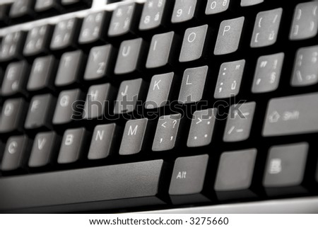 close up detail of a black computer keyboard