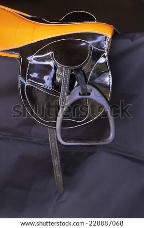 Close up detail of a horse racing saddle and stirrups - stock photo