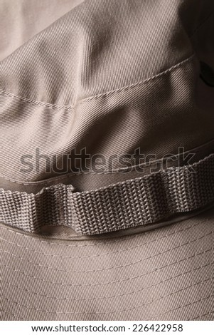 Close up detail of a khaki brown boonie hat - stock photo