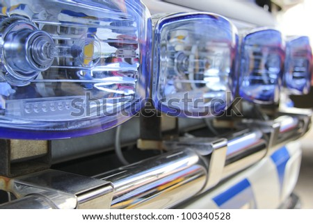 close-up detail of a row of blue flashing lights on emergency rescue and recovery vehicle