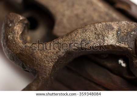 Close up detail of a silver flintlock mechanism with an engraved pattern on an old wooden pistol. - stock photo