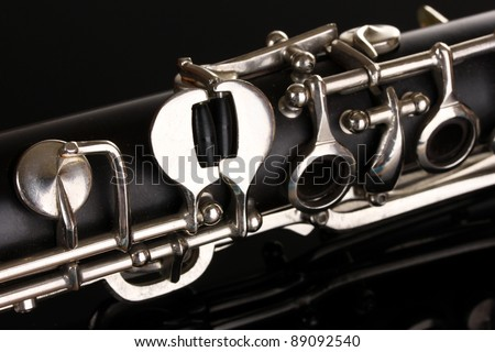 close up detail of clarinet on black background - stock photo