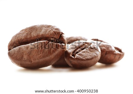 Close-up detail of coffee beans isolated on white background. Beautiful macro of brown coffee beans. - stock photo