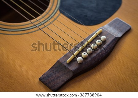 Close up detail of guitar string and blurred background. - stock photo