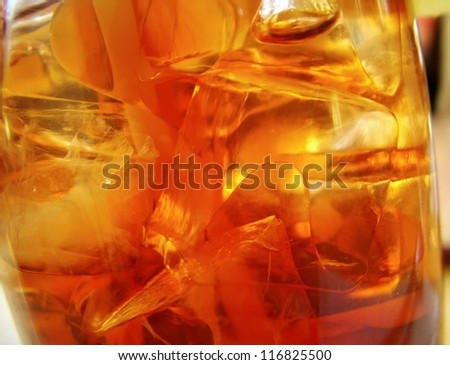 Close-up detail of ice in a glass filled with cola drink