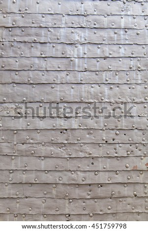 close up detail of medieval castle door texture with metal armor plates - stock photo