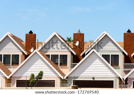 Close up detail of modern town houses with electric fencing. - stock photo