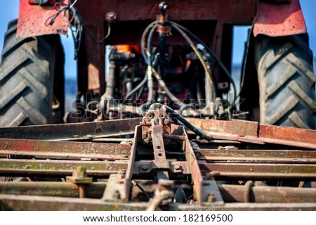 Close-up detail of tractor or machine harvesting the field - stock photo