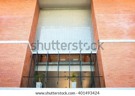 Close up detail of university, hospital, or office building building with red brick wall - stock photo