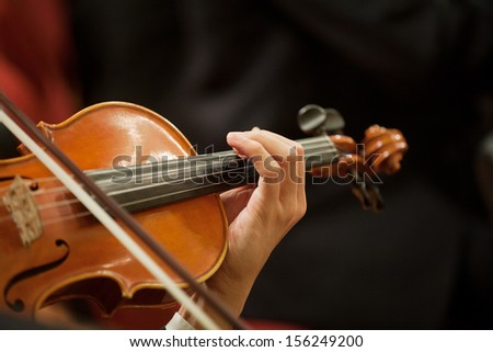 Close up detail of Violin being played in Orchestra - stock photo