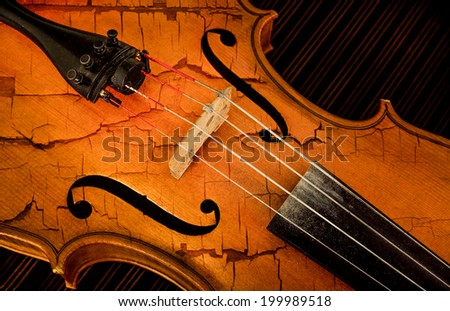 Close-up detail of violin in filtered style as cracked paint - stock photo