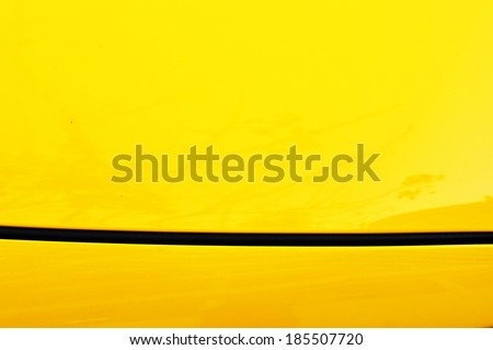 close up detail of yellow car - stock photo