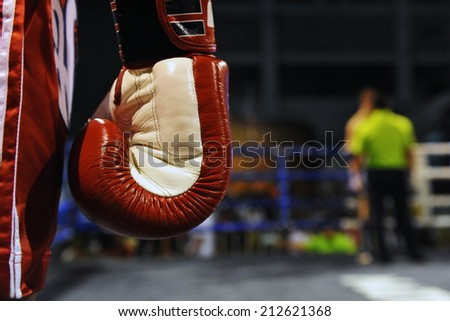 Close-up Detail View of a Boxing Glove During a Fight - Image Has a Shallow Depth of Field with Focus on the Glove - stock photo