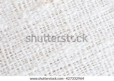 Close up detail view of a piece of linen cloth showing the pattern of the weave of a natural fabric.selective focus. - stock photo
