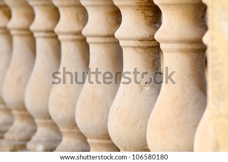 Close up detail with depth of field of balustrade with beige sandstone Columns. - stock photo