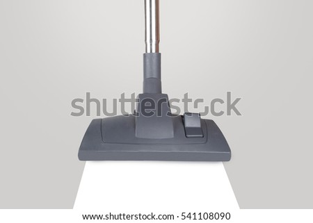Close up detailed front view of vacuum cleaner vacuuming dusty surface, isolated on white background.